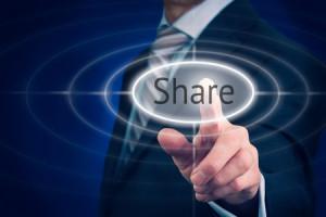 30754171 - businessman pressing a sharing concept button.