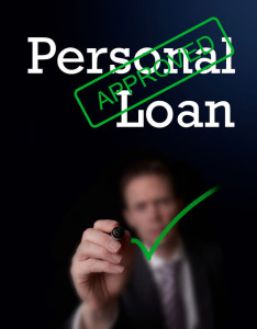28172354 - an underwriter writing personal loan approved on a screen.
