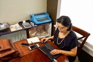 78222731 - hispanic woman working from home